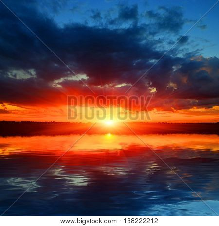 Hot sunset in nice sky over water