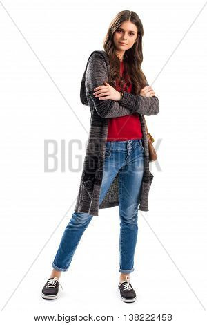 Woman in striped outerwear. Jeans and sweater coat. Young model with folded arms. New clothing items in lookbook.
