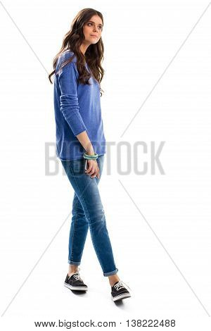 Lady in blue sweatshirt. Jeans and black footwear. Model holds cell phone. Style of our time.