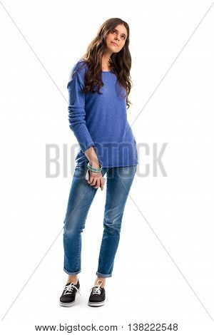 Woman in blue sweater. Young lady holding cell phone. Casual apparel of light colors. How to dress simple.