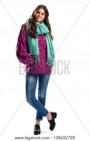 Girl in short purple coat. Black shoes and turquoise scarf. Colorful outerwear for autumn. Combination of attractive colors.