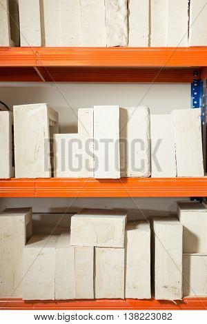 Plaster Molds For Various Scale Models Arranged In Shelves