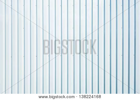 White corrugated metal fence background in the warehouse.
