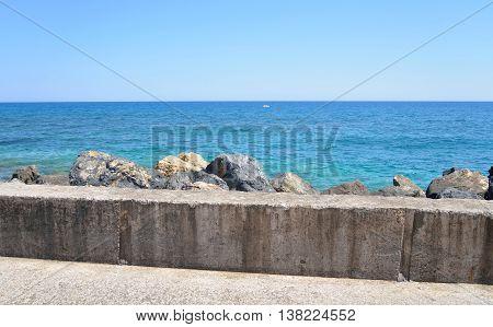 Fragment of pier and Cretan Sea near Stalida Crete Greece.