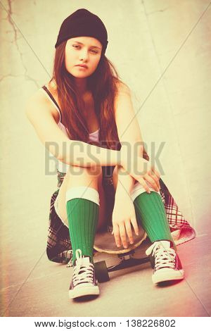 Teenage skater girl with vintage effect