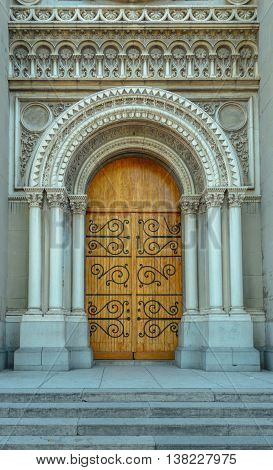 Church entrance with wooden door front view