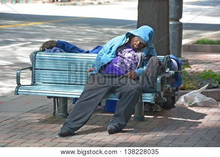 CHARLOTTE NORTH CAROLINA USA JUNE 20 2016: Homeless man in a park, chronically homeless in Charlotte, about 450 people