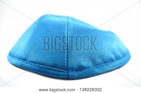 Blue yarmulkeh also known as kippah used in Jewish ceremonies (Bar Bat B'nei Mitzvah Hanukkah Passover Yom Kippur Rosh Hashanah et al.)