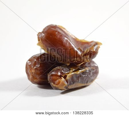 Brown sweet dried date fruits isolated on white