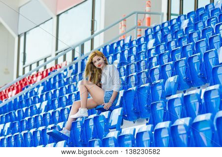 Fashion business woman in sunglasses on the grandstand
