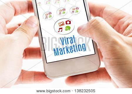 Close Up Two Hand Holding Smart Phone With Viral Marketing Word And Icons, Digital Concept