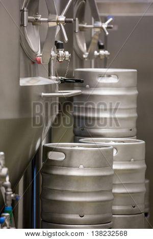 Close-up of distillery and keg at bewery