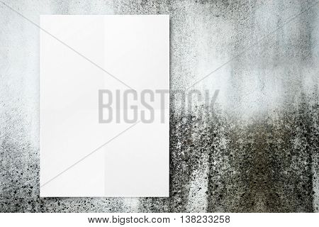 Blank Folded Paper Poster Hanging On Dirty Concrete Wall,template Mock Up For Adding Your Design