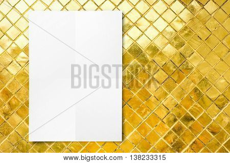 Blank Folded Paper Poster Hanging On Mosaic Golden Tiles Wall,template Mock Up For Adding Your Desig