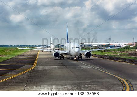 Airplanes Going To The Runway To Take Off At Soekarno-hatta International Airport