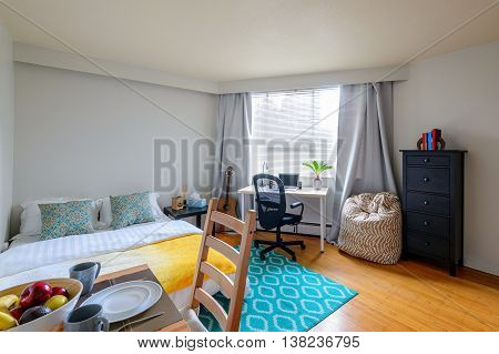 Cozy studio student apartment with a combined dining room bedroom and office