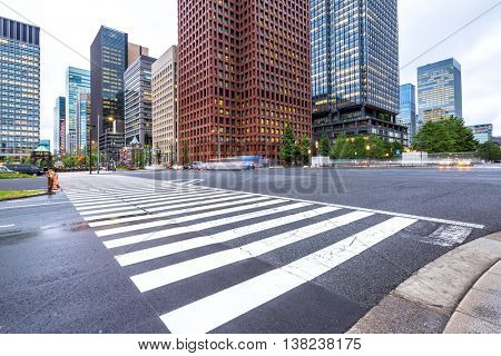 traffic on road intersection in downtown of tokyo