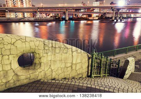 bright illumination on Sumida river by night in Tokyo city