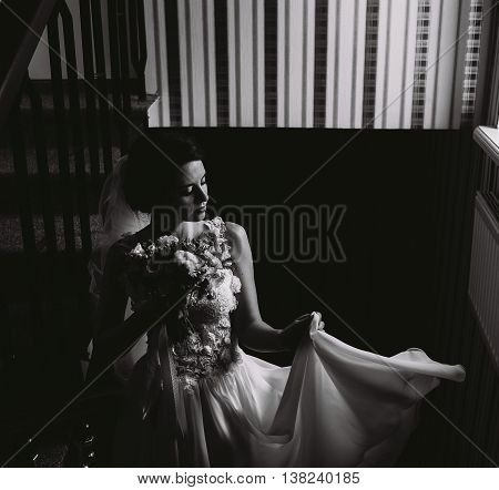 Bride posing on the stairs to the chamber