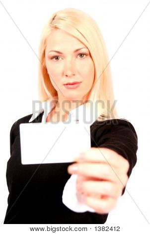 Beautiful Blonde Business Woman Holding Business Card In Front Of Her
