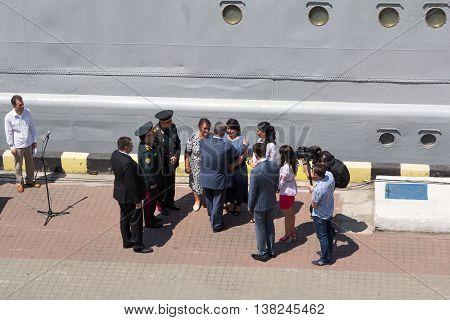 Odesa, Ukraine - July 03, 2016: President Petro Poroshenko talks to the parished officer's family. Navy day celebration in Odesa