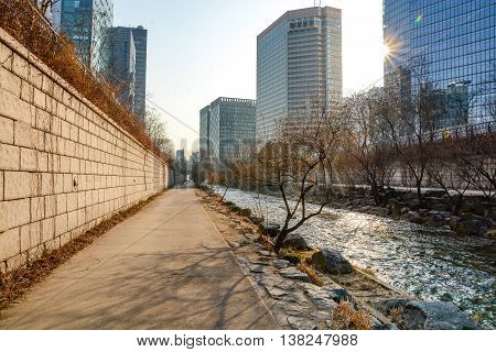 Cheonggyecheon stream and pedestrian walkway in winter. The stream is a modern public recreation space in downtown Seoul South Korea
