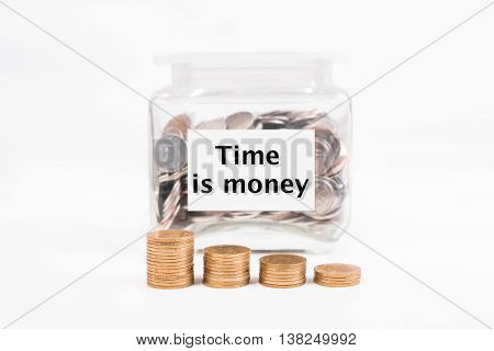 piggy bank pile gold coin with word text Time is money on paper in glass piggy bank.(business bank and finance concept)