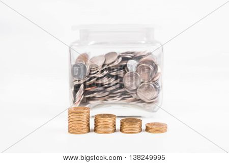 piggy bank pile gold coin with word text save money on paper in glass piggy bank.(business bank and finance concept)