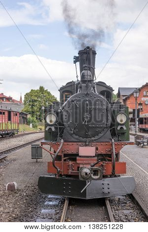 Historic steam powered railway train at train station