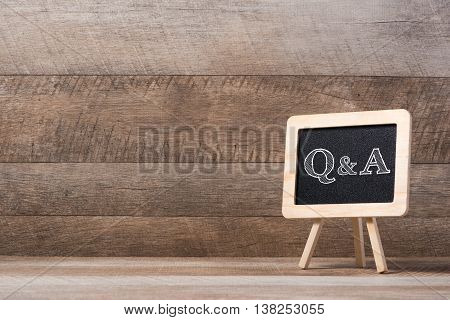 blackboard with Q&A text on wood floor