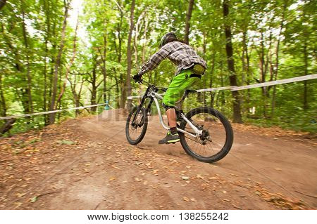 Rider on bicycle downhill a mountain area.