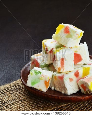 Gumdrop white chocolate fudge on a plate