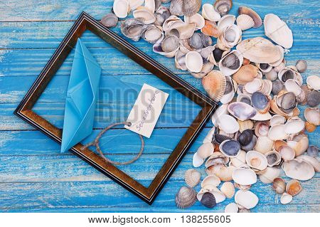 Sign Sea Adventure And Paper Boat With Shells And Photo Frame