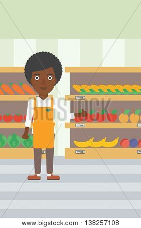 An african-american female supermarket worker showing thumb up on the background of shelves with vegetables and fruits in supermarket. Vector flat design illustration. Vertical layout.