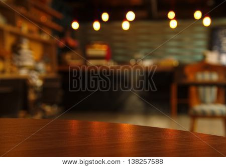 curve wood table surface with blur bar or cafe scene at night background
