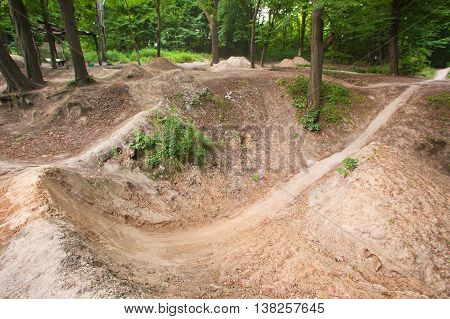 Track for dirt jumping on bikes at the forest.