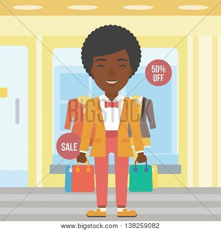 An african-american woman holding shopping bags on the background of boutique window with dressed mannequins. Happy young woman carrying shopping bags. Vector flat design illustration. Square layout.