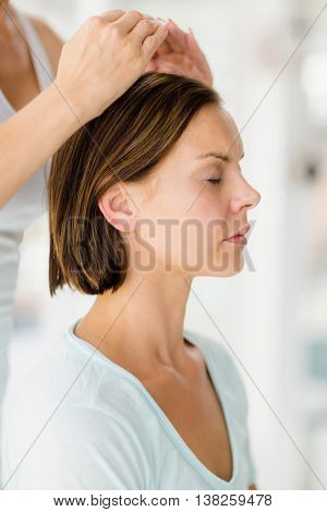 Cropped image of masseur giving massage to woman at spa