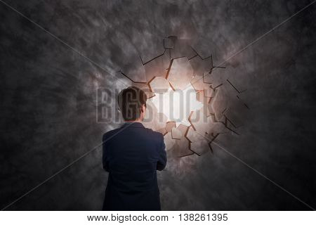 businessman breaking trough a wall business concept