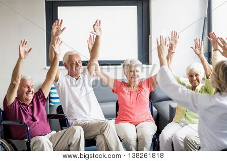 Seniors doing some exercises in a retirement home