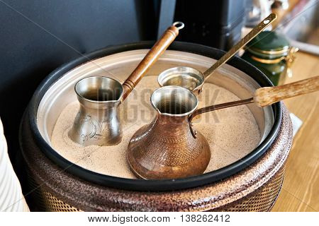Preparation Of Turkish Coffee In Cezve In Sand