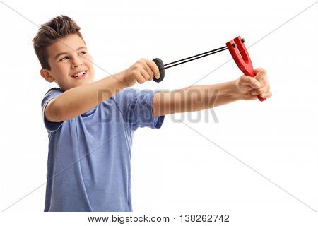 Cheerful little kid shooting with a slingshot isolated on white background
