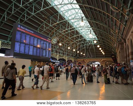 Sydney - February 25 2016: Scoreboard Central Station in Sydney and a lot of people and tourists traveling railways February 25 2016 Sydney Australia