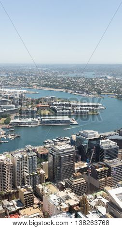 Sydney - February 25 2016: View of the city from the top of Sydney Tower visible infrastructure of the city the sea and plenty of Sydney Harbour skyline February 25 2016 Sydney Australia