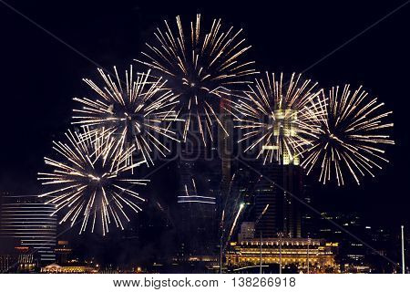 holidays, celebration, party, festival and new year concept - beautiful fireworks at night sky