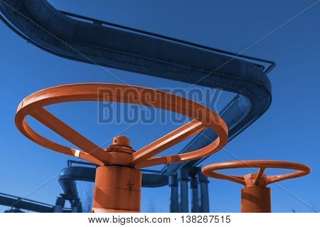 Two control valves on the background of gas pipes