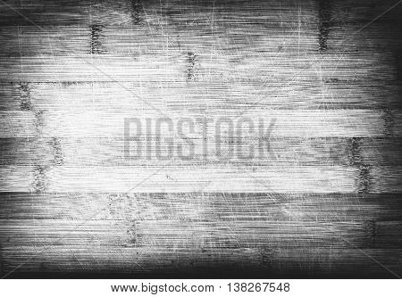 Old wooden bamboo board Texture with scratches in monochrome.