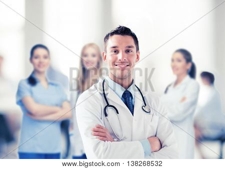 healthcare and medical concept - young male doctor with stethoscope