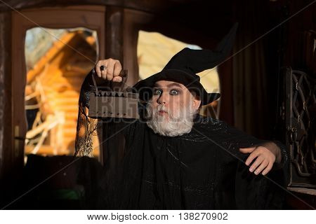 Old Wizard With Coal Iron