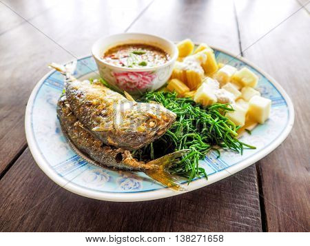 Chili sauce mackerel fried and boiled vegetables marcro Thai food.